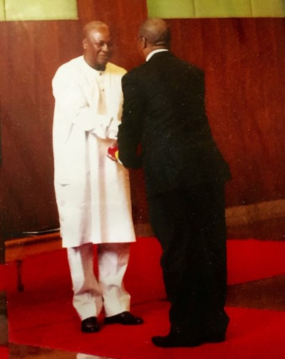 His Excellency Major General Carl S. Modey receiving credentials from His Excellency President John Mahama